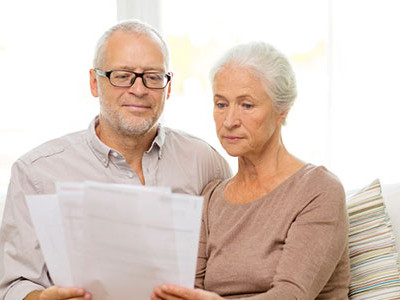 Elderly Couple Looking At Their Insurance Papers