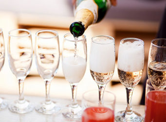 Champagne being Poured At Holiday Party